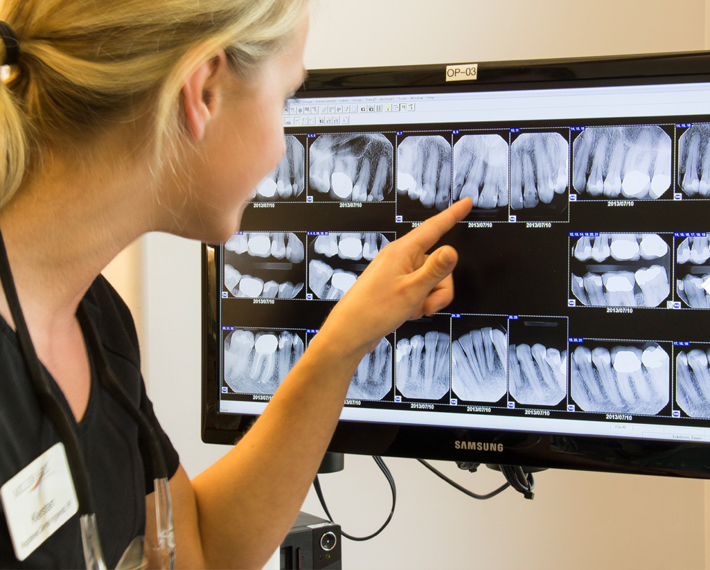 Staff looking at teeth x-rays