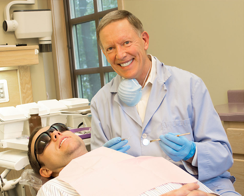 dr. gregory kaake performing dental checkup at miller hill dental